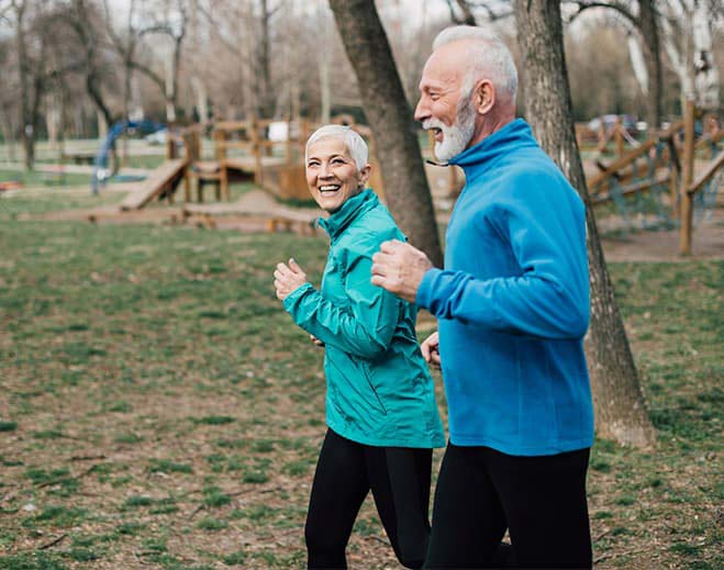elderly couple jogging