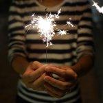 person-holding-sparkler-150x150